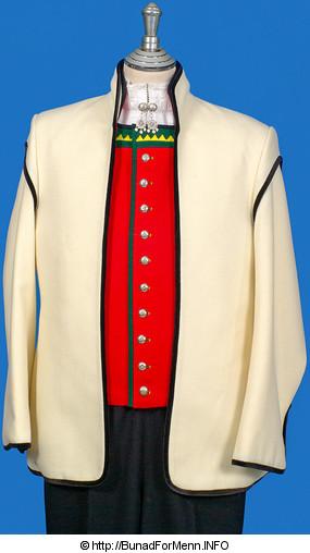 Vesten er laget av rød Engelsk klede med grønne biser og utpreget mønster på krage og foran i halsen. Rød vest til Sognebunad med gult mønster på kragen.