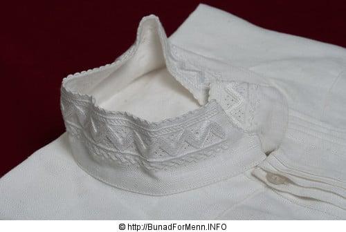 Linskjorte med broderinger som er utført for hånd. Linskjorten tåler kokvask
